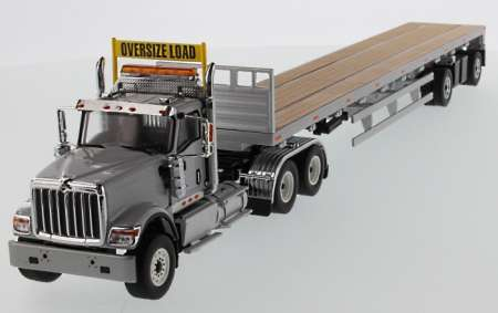HX520 Tandem Tractor, 53' Flat Bed Trailer grey/silver